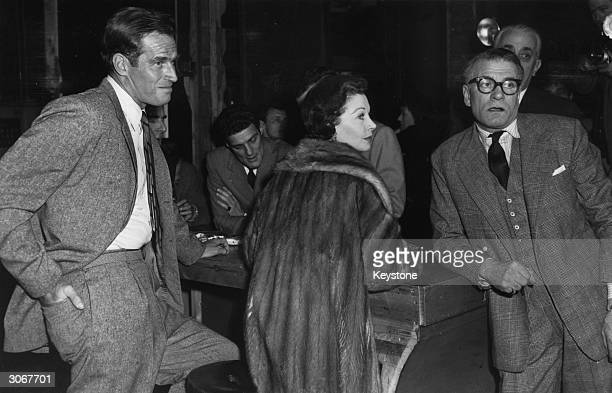 Left to right Charlton Heston Vivien Leigh and her husband Laurence Olivier at rehearsals for a midnight charity matinee in aid of the Frejus...