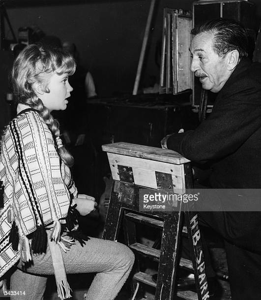 American film producer Walt Disney talking to British actress Hayley Mills on the set of his new film 'The Castaways' in which Miss Mills stars