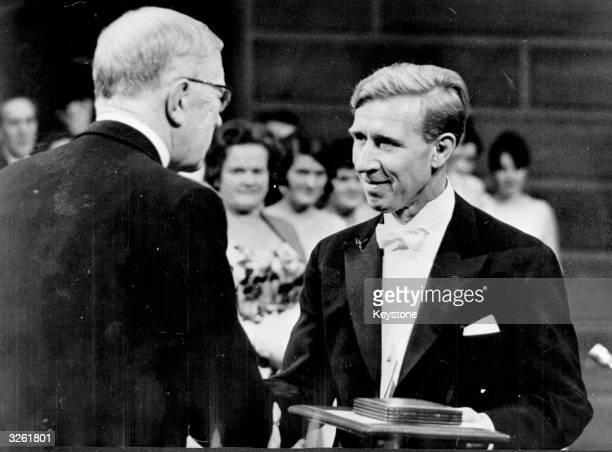 Germanborn US biochemist Konrad Bloch is awarded the Nobel prize for physiology or medicine by King Gustaf VI Adolf of Sweden in the Concert Hall...
