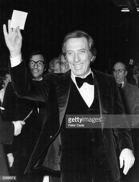 Popular American singer Andy Williams arrives at the Talk Of The Town in London's Leicester Square for a charity cabaret show in which he stars with...
