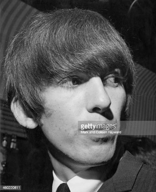 George Harrison from The Beatles posed behind the bar at the Wimbledon Palais in South London on 14th December 1963