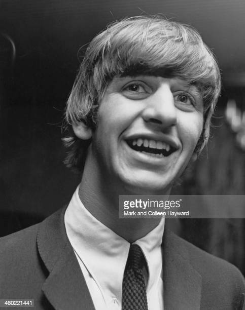 Ringo Starr from The Beatles posed behind the bar at the Wimbledon Palais in South London on 14th December 1963