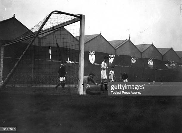 The Huddersfield Town goalkeeper clears the ball at the expense of a corner during a match against Arsenal at Highbury