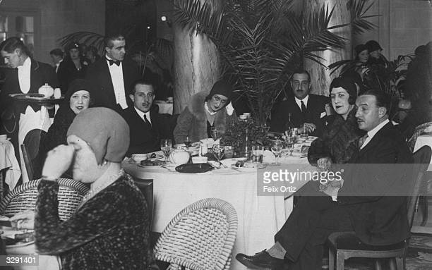 The Infante Don Jaime Duke of Segovia takes tea at the Hotel Ritz in Madrid He is attending a lottery for the benefit of the capital's poor children