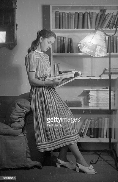 A model wearing a dress influenced by the new look style pioneered by Christian Dior Original Publication Picture Post 4506 Last Year's Dress Gets...