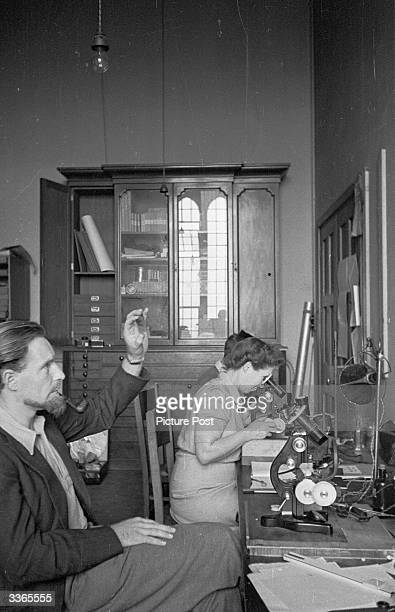 Scientists examine photographic plates in the Wills Physics laboratory at Bristol University. Original Publication: Picture Post - 4507 - The Riddle...