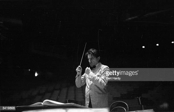 John Barbirolli conducting the Halle orchestra. Original Publication: Picture Post - 6416 - Orchestra Under Notice - pub. 1953