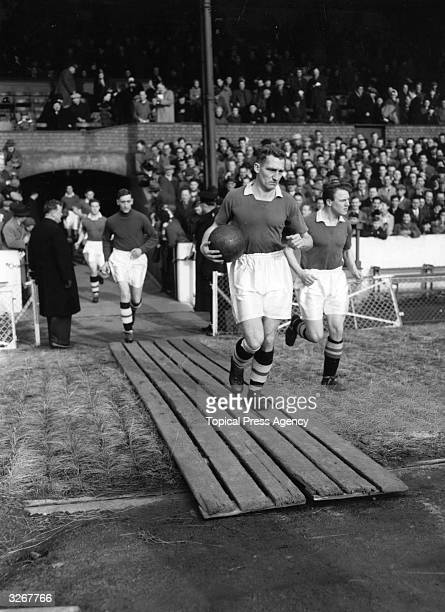 Roy Bentley captain of Chelsea leads his team out onto the football pitch