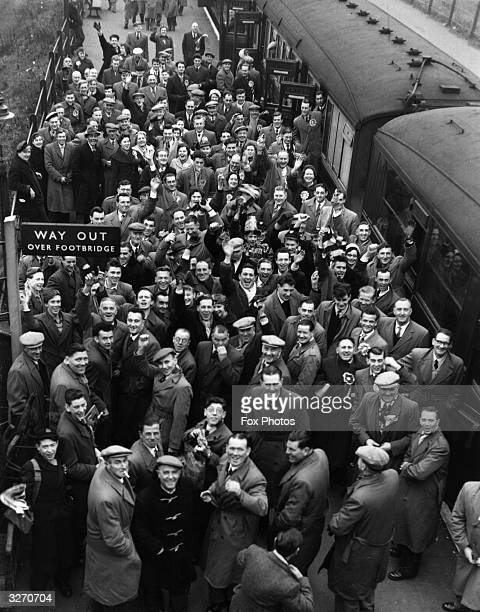A crowd of Norwich City FC supporters on arrival at Northumberland Park Station Tottenham north London bound for a FA Cuptie match against Tottenham...