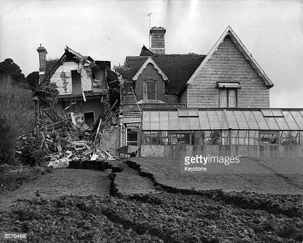 A three story mansion one of several homes wrecked by a landslide at the seaside resort of Lyme Regis Dorset The properties stand near a stretch of...