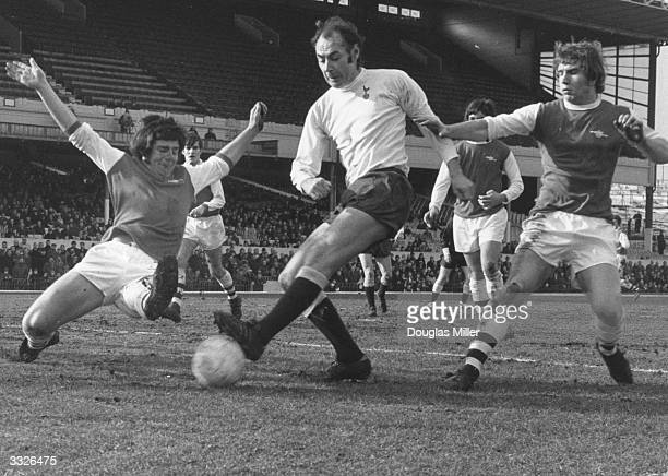 An Arsenal defender dashes in to block a shot from Alan Gilzean during a reserve game between Arsenal and Tottenham Hotspur at Highbury London