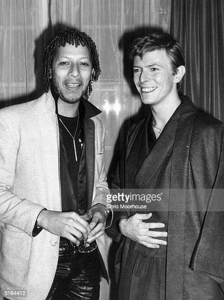 English pop star David Bowie with Peter Straker the star of the musical 'Tommy' at the Cafe Royal in London