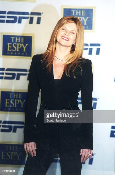 Canadian actor Lolita Davidovich stands in front of a wall of logos and smiles at the eighth annual ESPY Awards MGM Grand Hotel Las Vegas Nevada She...