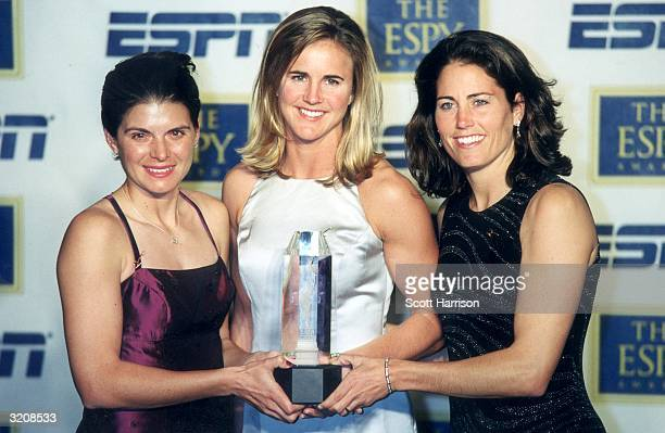 Left ti right US Women's World Cup soccer team players Mia Hamm Brandi Chastain and Julie Foudy hold the award for Team of the Year on behalf of...