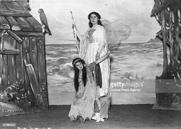 Lord and Lady Willoughby de Broke's pantomine 'Robinson Crusoe' at Compton Verney 'Fairy of the Island' poses with the 'Spirit of the Storm'
