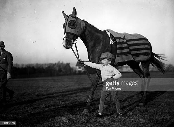The four-year-old son of Epsom trainer Fred Winter, also called Fred, at Epsom with racehorse Buladar.