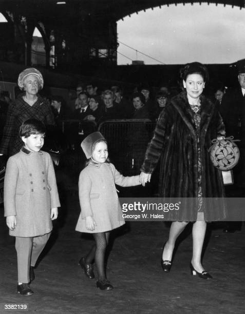 Princess Margaret the younger sister of British Queen Elizabeth II arriving back in London with her two children Viscount Linley and Lady Sarah...