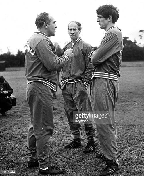 Sir Alf Ramsey the England Team Manager talking to Norman Hunter while Bobby Charlton stands in the centre