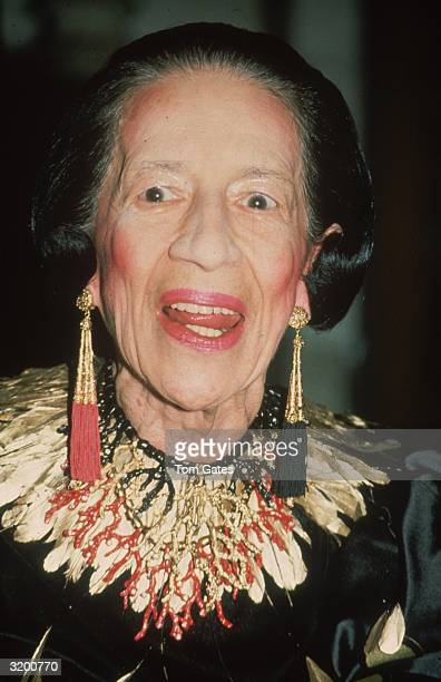 Fashion editor Diana Vreeland wearing a gold collar piece and long tassel earrings at an event held at the New York Public Library on 42nd Street New...