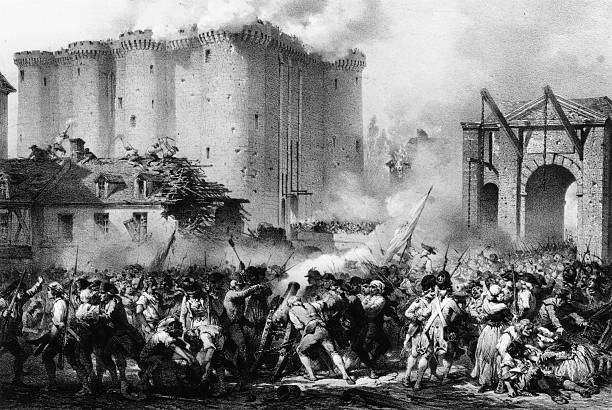 French troops storming the Bastille during the French...