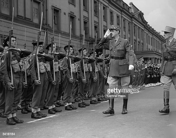General Charles de Gaulle inspecting the newlyformed Commandos of the Fighting French at Wellington Barracks during a parade to mark the Bastille Day...