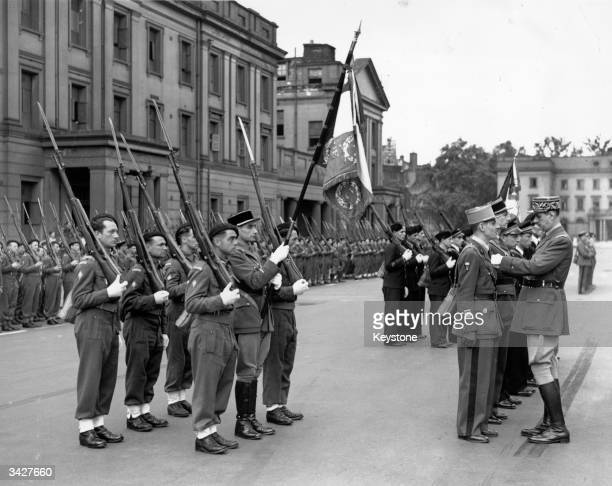 General Charles De Gaulle presenting medals to members of the Free French Army at Wellington Barracks, London.