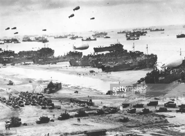 Fleets of US transport and landing craft disgorge reinforcements and supplies for the US troops who liberated the Contentin peninsula the deepwater...