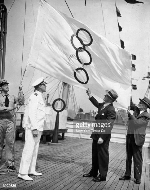 Full-length view of Quartermaster Richardson L. Bangs, Captain John W. Anderson, Avery Brundage, President of the United States Olympic Committee ,...