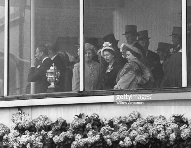 King George VI Queen Elizabeth and Princess Elizabeth watching a wet Ascot from the Royal Box