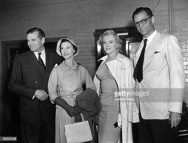 American film star Marilyn Monroe with her husband Arthur Miller being greeted by Sir Laurence Olivier and his wife Vivien Leigh
