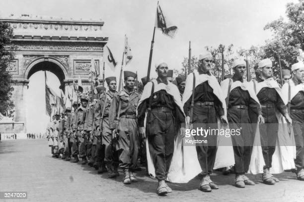 Soldiers of the special Harkis regiment from Algiers marching past the Arc de Triomphe and down the Champs Elysees during the annual Bastille Day...