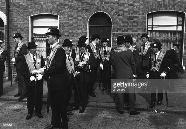 Belfast Orangemen gather prior to marching in celebration of the battle of the Boyne the victory of Dutch Protestant King William III over Roman...