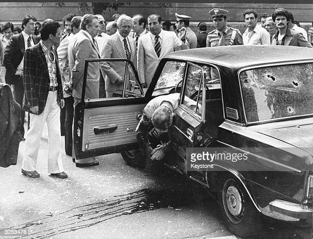 Public Prosecutor Vittorio Occurso slumps in his car after having been assassinated as he left home in Rome by the Neo Fascist group 'Ordine Nuovo'.