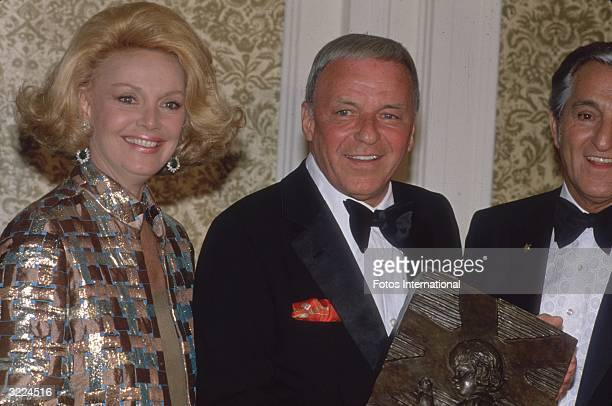 American singer and actor Frank Sinatra with his fourth wife actor Barbara Marx and American comedian Danny Thomas at the St Jude's Children's...