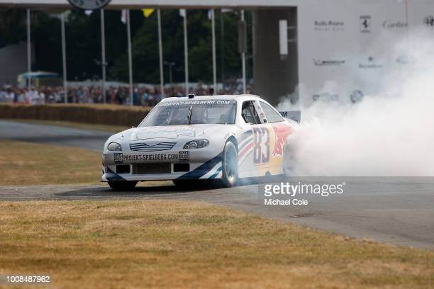 2007 Toyota Camry 'doing donuts' entered by Red Bull and driven by Patrick Friesacher at Goodwood on July 14th 2018 in Chichester England