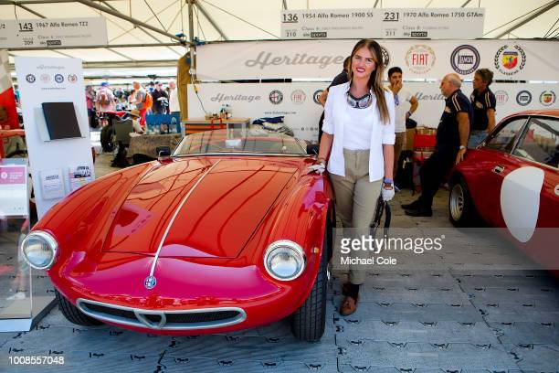 Shannon Warden standing beside the unique 1954 Alfa Romeo A/R 1900 Sport Spider at Goodwood on July 14th 2018 in Chichester England