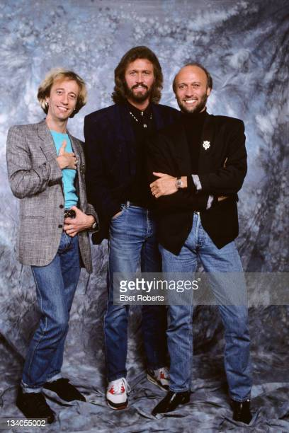 14th JULY: The Bee Gees posed together in New York City on 14th July 1989. Left to right: Robin Gibb, Barry Gibb and Maurice Gibb.