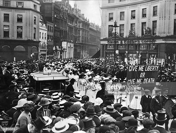 A memorial procession for the suffragette Emily Davison passing through Shaftesbury Avenue London