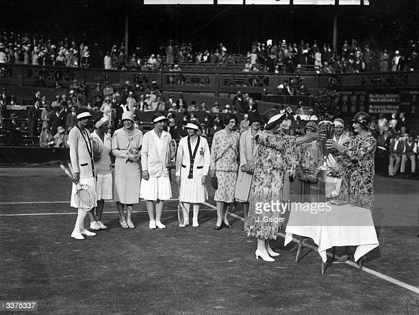 Lady d'Abernon presenting the Wightman Cup to Mrs Mabgro Dato nonplaying England captain at Wimbledon