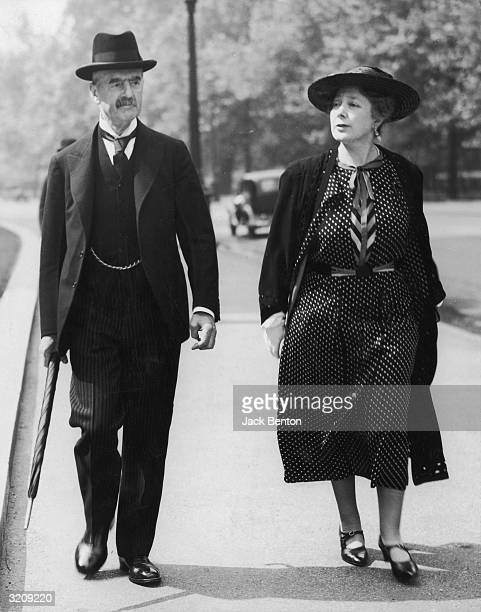 Fulllength image of British Prime Minister Neville Chamberlain and his wife Anne walking together in St James's Park London England Later that day he...
