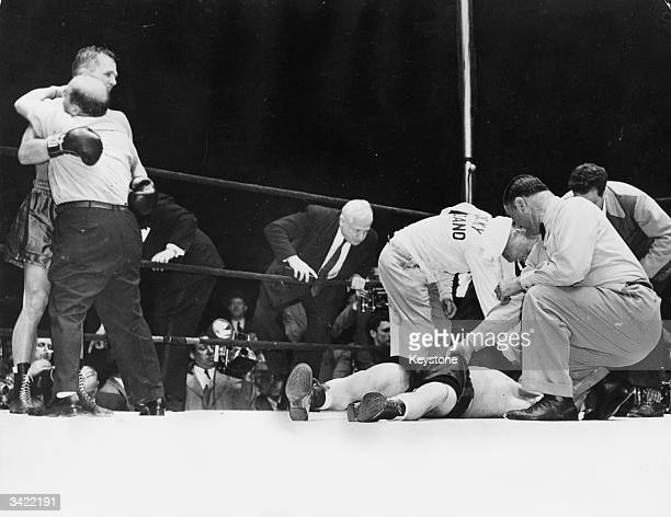 New middleweight champion Tony Zale is hugged by his manager whilst the unconscious Rocky Graziano is seen trying to be revived after being knocked...