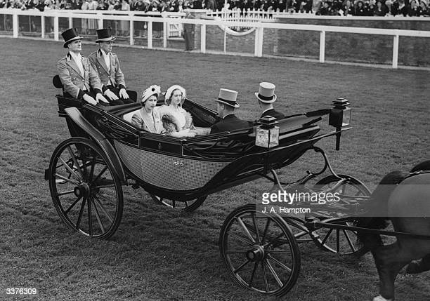 Princess Elizabeth later Queen Elizabeth II of Great Britain Princess Margaret and the Duke of Edinburgh at the Epsom Racecourse during the Derby