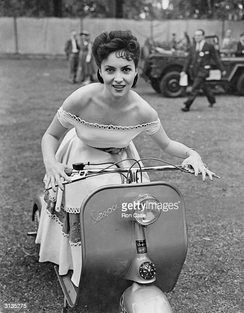 Italian actress Gina Lollobrigida attends the Great Film Garden Party at Morden Hall Park in Surrey, on a Vespa motor scooter. She is in Britain to...