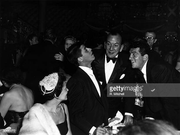 American comedy duo Jerry Lewis and Dean Martin with the English playwright and actor Noel Coward