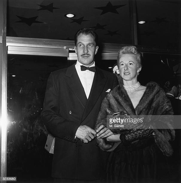 EXCLUSIVE American actor Vincent Price and his wife Mary enter a theater for the premiere of director William Wellman's film 'The High and the...