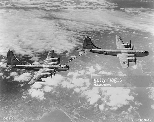 A US Airforce Boeing B29 tanker uses a 'flying boom' to refuel a B50 medium bomber in midair