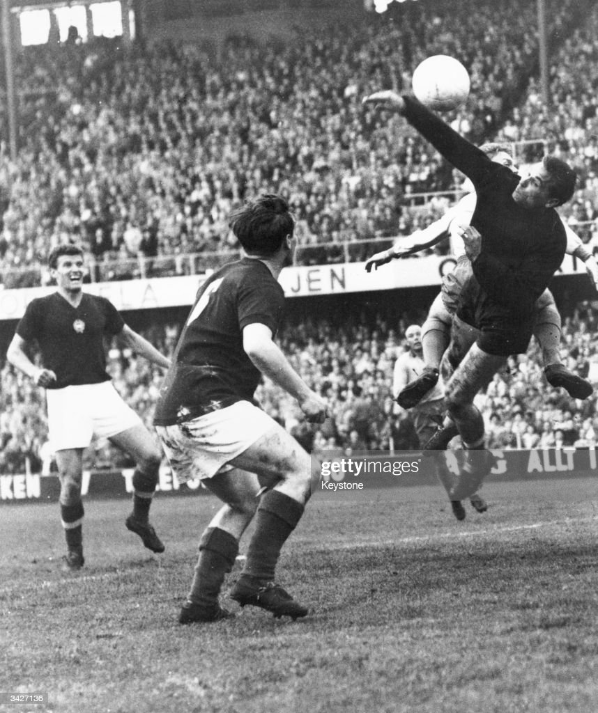 The Hungarian goalkeeper (right) reaches up to save a goal during a World Cup match between Sweden and Hungary in Sweden.
