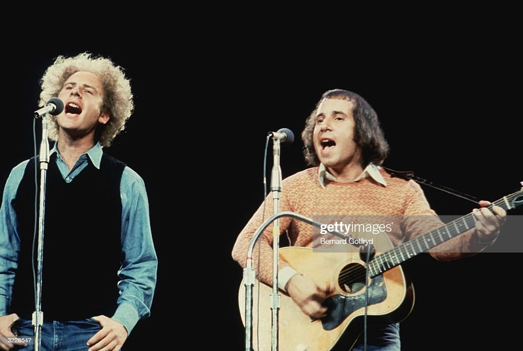 Art Garfunkel (L) and Paul Simon, of the American folk group Simon and Garfunkel, performing on stage at the 'Together With McGovern' concert, Madison Square Garden, New York City. The concert was a benefit for Democratic presidential candidate George McGovern.