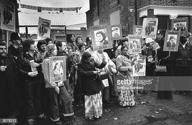 Pickets outside Grunwick photo-processing Laboratory in Willesden, London, holding posters of people they claim are still working.