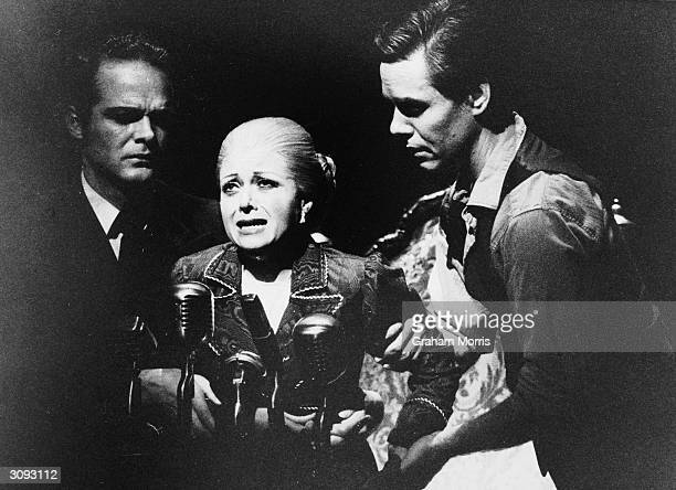 An aged Eva Peron played by Elaine Paige being helped to a microphone to make her last speech in the musical 'Evita' by Andrew LloydWebber and Tim...